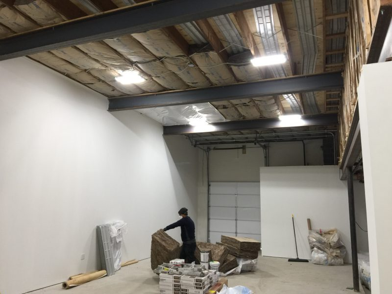 Man installing IK10 in ASSI warehouse
