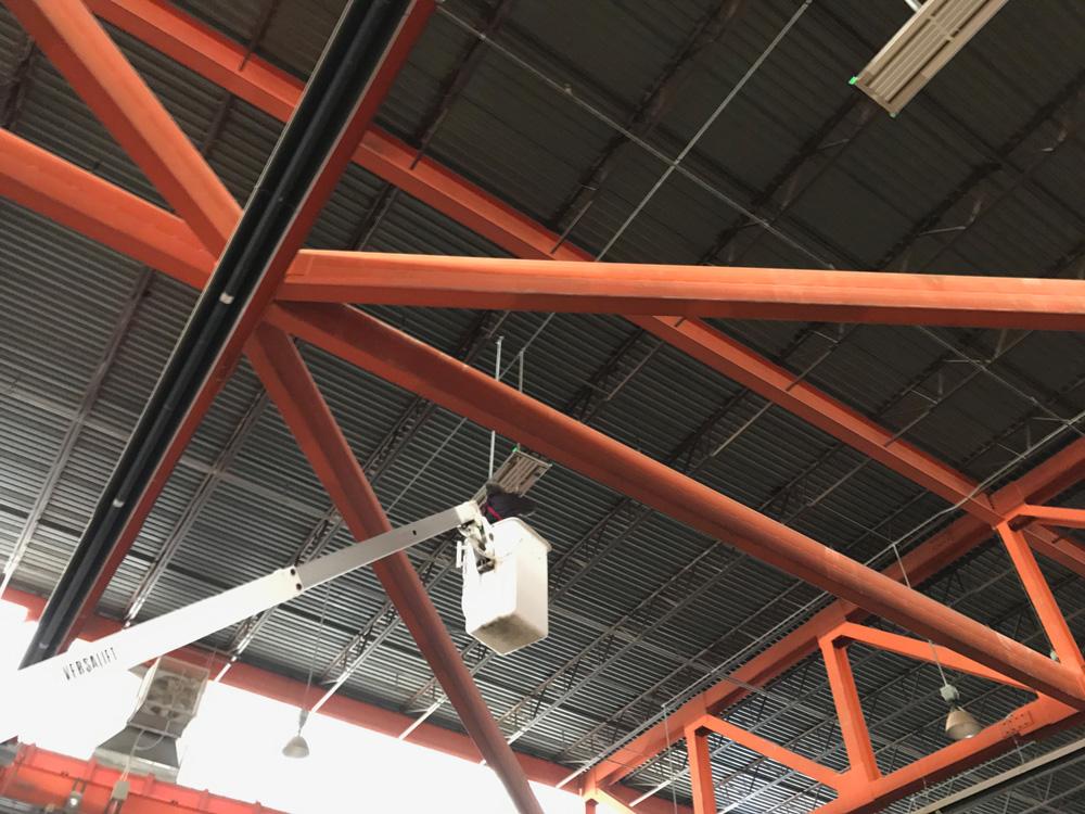Man installing IK10 Series Lighting in LCCC Arena