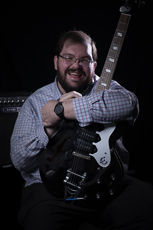 Nick Martin with guitar