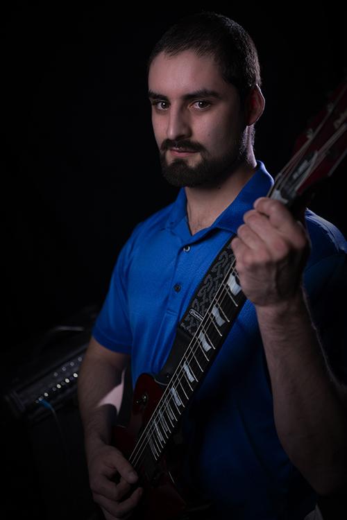Sam Preciado with guitar