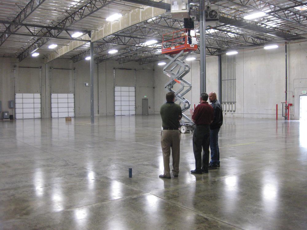 Men installing IK10 Series in PolyCorp Warehouse